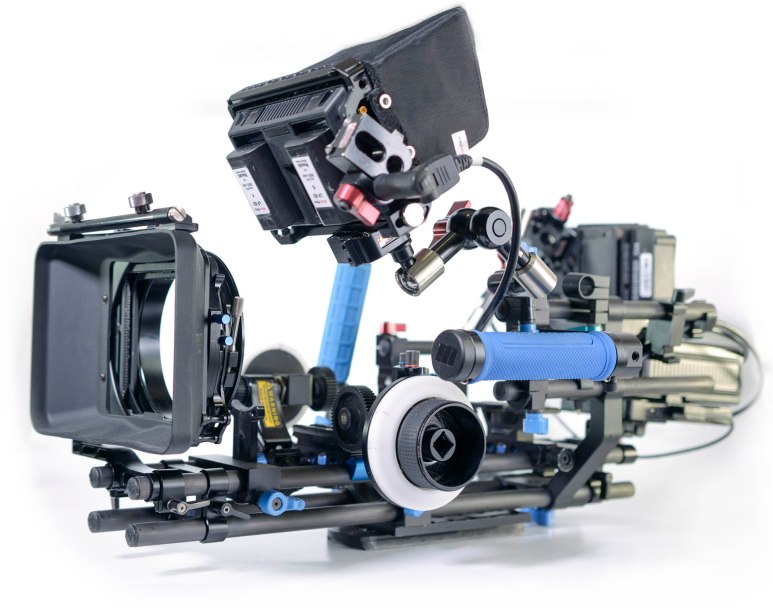 "The base of 'Ruby' is built on two pair of RedRock 18"" carbon fibre rods stacked to separate the optical and stabilisation attachments. The top rods feature the camera's baseplate, lens support, Focus / zoom wheels, and a light weight matt box that can host two 4x4"" filter trays. The lower rods hold the side frame, handles, and universal Zacuto arms for mounting screens and recorders. A universal cheese plate also features on the lower rods for mounting to tripods or shoulder mounts."